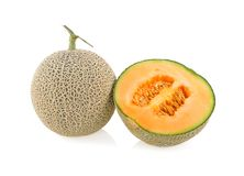 Whole and cut piece ripe Japanese orange melon with stem on white background stock photography