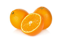 Whole and cut ripe orange on white background. Whole and cut ripe orange on awhite background royalty free stock photography