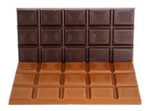 Whole dark and light chocolate bars isolated. Towards white background stock photos