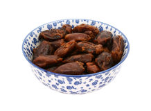 Whole dates in a blue and white china bowl Royalty Free Stock Photos