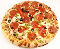 Whole deluxe pizza Stock Photo