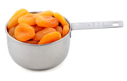 Whole dried apricots presented in an American metal cup measure Stock Image