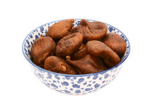 Whole dried figs in a blue and white china bowl Stock Photos