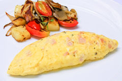 Whole eggs omelet. With side dish Stock Photo