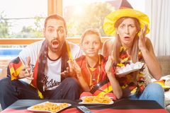 Whole family cheering for the German soccer team in front of TV Stock Image