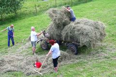 Four generations family is harvesting hay, Czech Republic  Royalty Free Stock Photography
