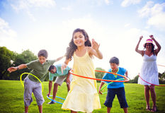Whole Family Hula Hooping Outdoors Royalty Free Stock Image