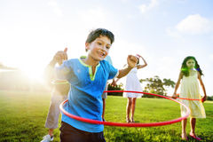 Whole Family Hula Hooping Outdoors Togetherness Concept royalty free stock images