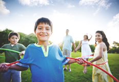 Whole Family Hula Hooping Outdoors Togetherness Concept Stock Photography