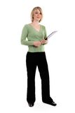 Whole figure of a businesswoman. Whole figure of a young businesswoman holding folder royalty free stock photo