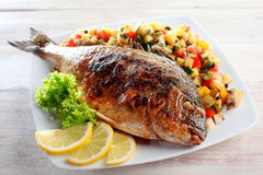 Whole Fish with Lemon Served with Fresh Salsa Royalty Free Stock Images