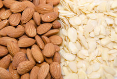 Whole and flaked almonds. Background of whole and flaked almonds Royalty Free Stock Photo