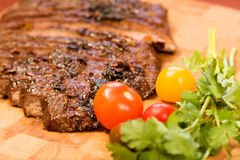 Whole Flank Steak. Whole Chipotle Grilled Flank steak on wood cutting board royalty free stock photography