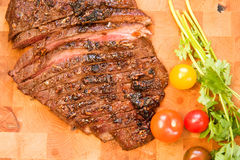 Whole Flank Steak. Whole Chipotle Grilled Flank steak on wood cutting board stock photography