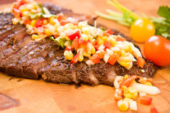 Whole Flank Steak. Served with corn salsa stock images