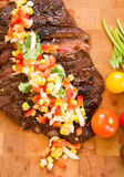 Whole Flank Steak. Served with corn salsa royalty free stock images