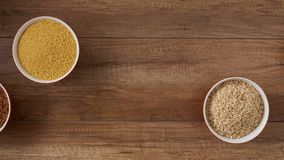 Whole foods diet base - various seeds in bowls sliding into frame stock footage