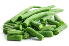 Whole French green string beans cut and isolated on white. Stock Image