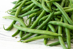 Whole French green string beans  on white rustic wood. Stock Photo