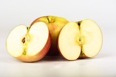 Whole fresh apple and two halves of apple. Close up royalty free stock photos