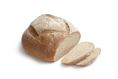 Whole fresh artisan loaf of bread and slices Stock Photos