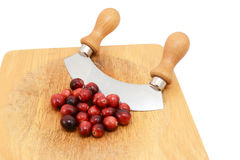 Whole fresh cranberries with a rocking knife Royalty Free Stock Images
