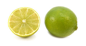 Whole fresh lime and cut half fruit Royalty Free Stock Photo