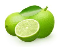 Whole fresh lime fruit with green leaf, lying and half stock photos