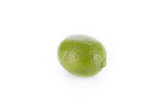 A whole fresh lime isolated on a white. Stock Image