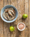 Whole fresh raw shrimps seafood in bowl. Ready to cook Stock Photos