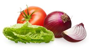 Red tomato, unpeeled onion with slice and green salad. Whole fresh red tomato with green leaf, unpeeled red onion with slice and green salad isolated on white Stock Image