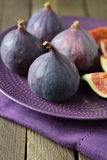Whole fresh ripe figs on a plate Royalty Free Stock Images