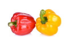 Whole fresh yellow and red bell pepper with stem on white backgr Stock Photos