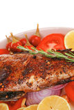 Whole fried bass on plate Royalty Free Stock Image