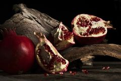 Whole fruit pomegranate and grains royalty free stock photo