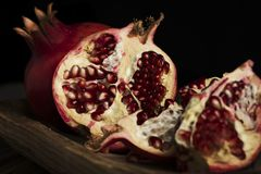 Whole fruit pomegranate and grains stock images
