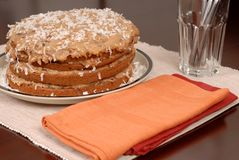Whole German Chocolate cake on table. A delicious whole German Chocolate cake on table Royalty Free Stock Photography