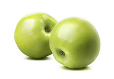 2 whole glossy green apples isolated on white background Stock Photography