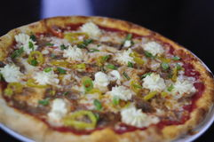 Whole Gourmet Pizza with Sliced Italian Sausage, Ricotta Cheese and Banana Peppers Stock Photography