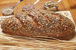 Whole Grain Bread. Loaf with accompanying ingredients Royalty Free Stock Photography