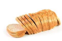 Whole grain bread. Fresh baked sliced whole grain bread on white background Stock Image