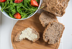 Whole Grain Bread with butter. And healthy salad for dinner Royalty Free Stock Photo