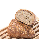 Whole grain bread cut in half Stock Image