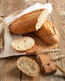 Whole grain bread (9 grain bread). On wooden background stock images