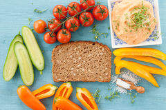 Whole grain bread and hummus. Slice of whole grain bread, vegetables and hummus stock images