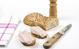 Whole grain bread an knife on  white background. Two slices w Royalty Free Stock Photo