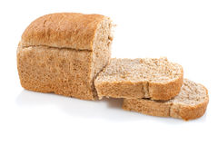 Whole grain bread loaf on a white background Royalty Free Stock Photos
