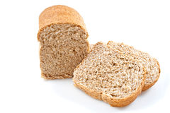 Whole grain bread loaves on a white background Royalty Free Stock Photo