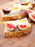 Whole grain bread with melted brie cheese and figs. Stock Images