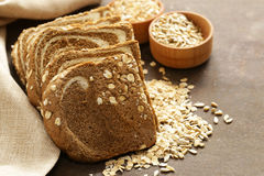 Whole grain bread with oat flakes. And seeds Stock Image